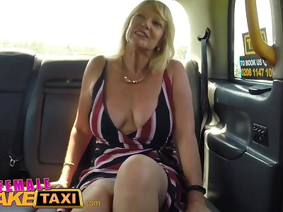 Female Fake Taxi Blonde milf shoots a load on sexy redheads tongue